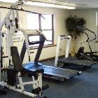 Exercise Room with Tv and other Amenities like Sauna, Steam Room, and more Hot Tubs.