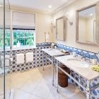 All Bedrooms Have Ensuite Bathrooms with Double Vanities and Rain Showers