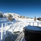 Relax in the Warmth of the Hot Tub While Watching the Skiiers and Boarders Come down Christmas Bowl.