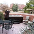Patio Area with Dining Table, Chairs, Charcoal Grill and Hot Tub