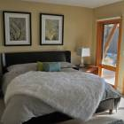 Master Bedroom with En Suite and View of Okanagan Lake.