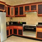 The Villa has a Modern, Full-Sized Kitchen with a Stove, Fridge, Dishwasher, and a Microwave Oven.