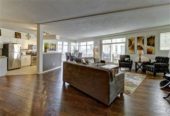 Newly Updated, Rare 4 Bedroom Condo at Discovery Bay with a Lake View