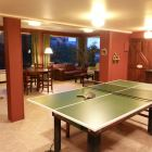 "Watch Tv Or Play Cards, Table-Tennis Or Air-Hockey in the ""Quincho Playroom"""