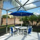Pool Deck Table and Chairs. - Have Lunch by the Pool under the Umbrella.