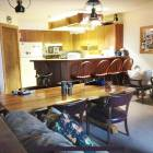 2 Brm: Open Concept Kitchen with Wine Rack and Eating Bar. Dining Room Table Seats 8.