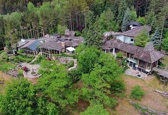 15,500-Sq Ft West Coast Inspired Home with Panoramic Views across  24-Acre