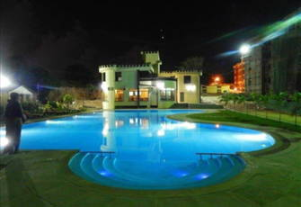 Sunset Paradise Apartments - Pool at Night