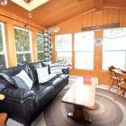 Sunroom with Leather Furniture and Flat Screen Tv