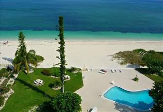 Spectacular Panoramic Beachfront Condo W/Central Air Conditioning and Pool