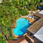 Pool and Deck are Located at the Front Side of a Corner Lot for Maximum Privacy.