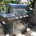 Stainless Steel Bbq with Rotisserie and Steak Searing Grill. Needs Hand Starting with Lighter. Propane Provided.