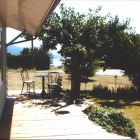 Relax on Porch with View of Okanagan Lake and Fruit Trees.