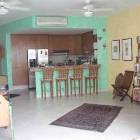 Wider View from the Living Room Toward the Kitchen