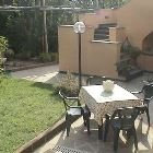 Well Maintained Lawn and Patio Table