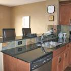 Kitchen has Granite Counter Tops