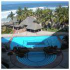 Pool Area and Glimpse of the Beach from the Suite - Pool Area is Large and Well Maintained and Landscaped.