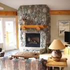 Living Room Seating with River Rock Fireplace and 40&Quot; Flat Screen TV.
