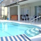 Pool and Lanai - with Plenty of Dining Furniture