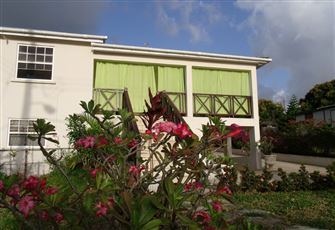 Comfortable, Self-Catering Apartment Set amid a Tropical Garden W/ Ocean View