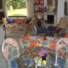 Living Room/Dining Room - the Condo is Furnished in Bright Mexican Colors that Will Brighten up the Winter Blues.  the Living Room has a New 32&Quot; Flat Screen TV and a View of the Lush Gardens.