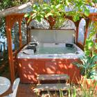 Jacuzzi Tub with Gazebo and White Tea Table to the Side, on Patio #1
