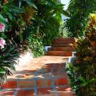Serpentine Steps Take you down through Lush Tropical Gardens to the Beach