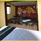 Oriental Tub - each House has 2 Units that Are Able to be Rented, this is one of the Bedrooms.