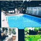 Swimming Pool, Solarium Leading to Deck and Front Garden
