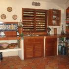 Downstairs Kitchen Area. - the Kitchen is Equipped with a Propane Cook-top, a Gas Refrigerator, and Cabinets with all the Essential Kitchen Ware Including a Mechanical Fruit Press for Preparing Fresh Orange Juice and 5-gallon Jugs with Purified Drinking Water (Provided Free of Charge).