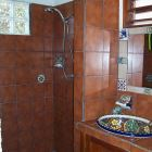 Downstairs Bathroom. - this is a Complete Bathroom with Warm Water Shower and Toilet. it has a Beautiful Hand-painted Talavera Ceramic Sink. our Snorkeling Gear (Masks, Fins, Snorkels) is Stored in this Bathroom and Can be Used Free of Charge.
