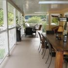 550 Sq Foot Covered Deck with Barbeque, Dining Table, and Lounge Chairs