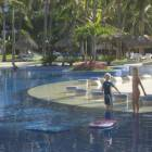 Kids Using Boards in Main Pool