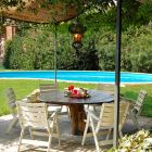 The Private Garden is Complimented by a Patio, a Wooden Table, Ten Chairs, Six Deck-Chairs and a Barbeque/Grill
