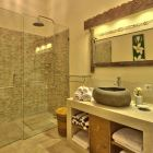 "Luxury and Comfort in a Marble and Stone En-Suite Bathroom, ""Bali Lou"" Shampoo, Conditioner and Body Wash Supplied."