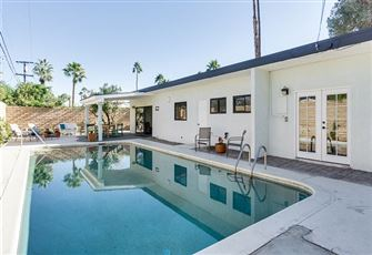 This 3br, 2ba Palm Springs Features an Open and Airy Interior and Private Yard w