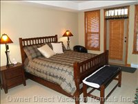 Master Bedroom with Queen Bed, Door to Hot Tub Deck.