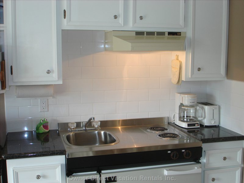 Kitchen with Granite Countertop and Tile Backsplash