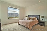 The Master Bedroom with Lake and Mountain Views