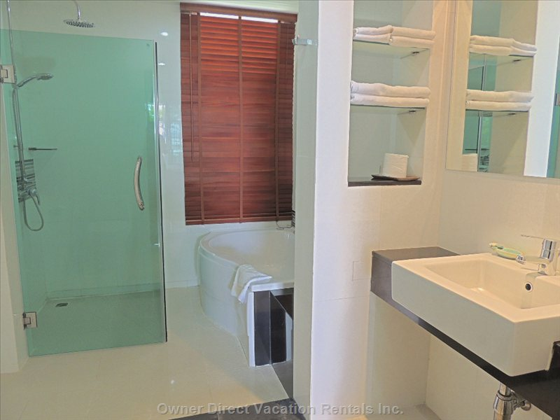 Modern Bathroom with Tub and Shower - Similar to but May Not be Exact Unit.