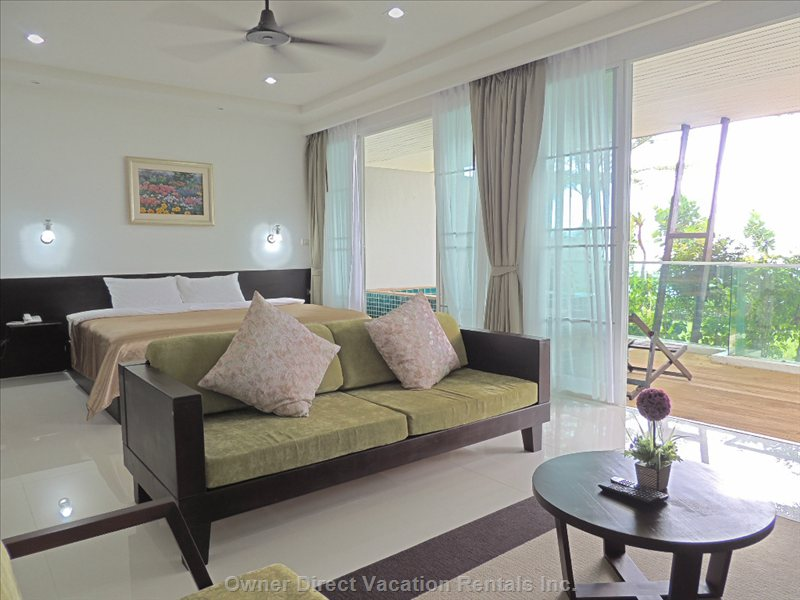 Spacious Bright Open-Concept Room with Private Terrace and Jacuzzi - Similar to but May Not be Exact Unit.