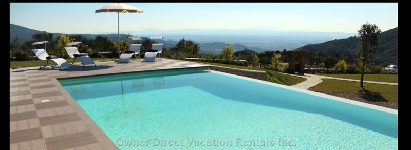 A Fabulous Infinity Pool, Views of Gardens and Tuscan Countryside.  The Distant Hill Towns and Montechio Castle.