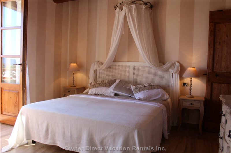Main Bedroom, with Access to Private Balcony Overlooking Pool