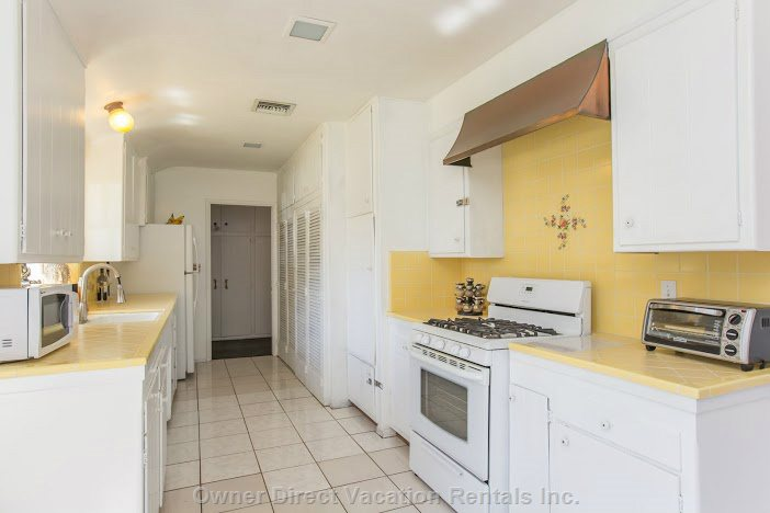 Large Kitchen with Oven, Dishwasher, Coffee Maker, Blender, Microwave, and Lots of Dishes/Glasses