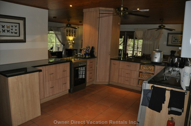 Open Plan Kitchen Overlooking Dining Room and Living Room.