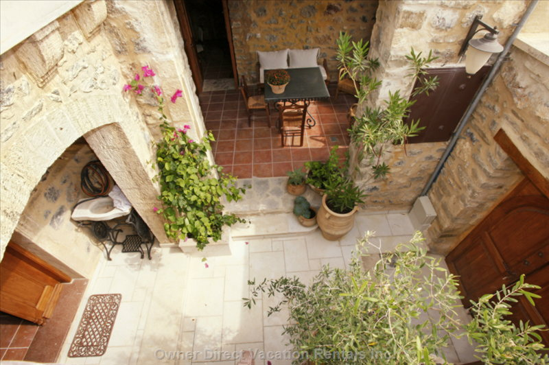 Courtyard and Patio Viewed from the Exterior Stone Stair to Upper Terrace