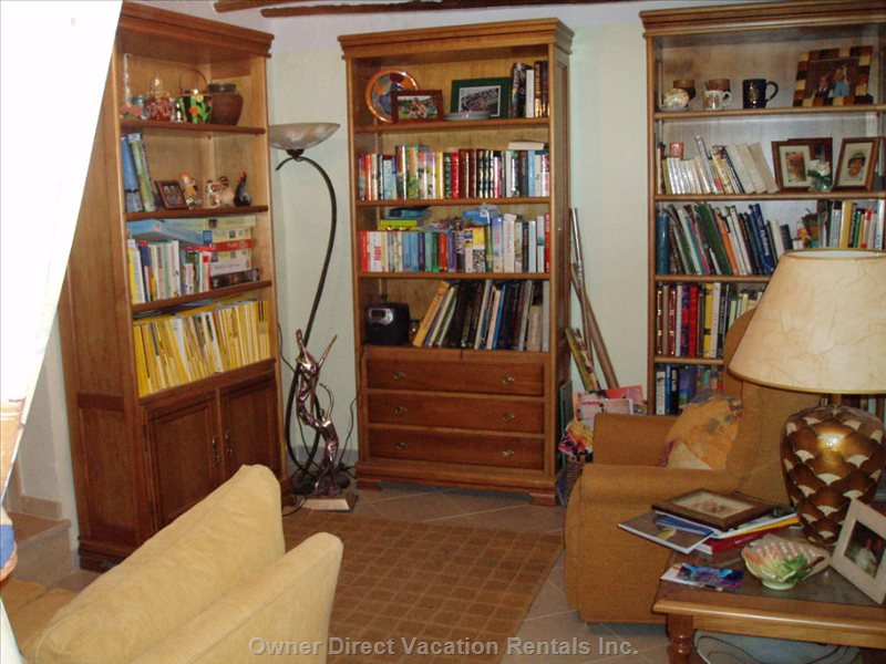 Library/Study - this is a Classical Style Room with its Original Restored Beams and Warm Colours to Relax and Have a Read Or Listen to Music from a Selection of Books and Cds.