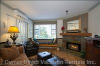 Lovely Livingroom with Window Seat Overlooking Village Trail with Peek-a-Boo View to the Olympic Plaza