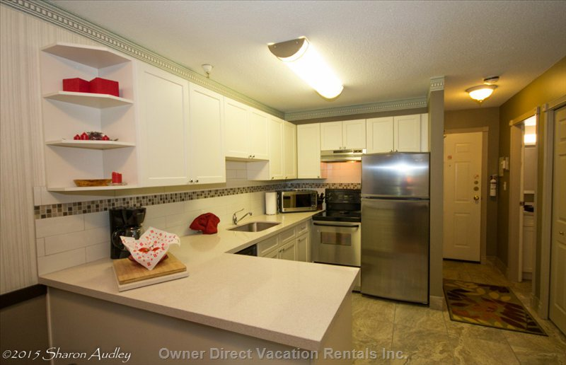 Quartz Countertops and Fully Equipped Kitchen