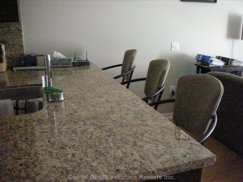 Bar Seating at the Granite Countertop